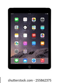 Varna, Bulgaria - February 02, 2014: Front view of Apple Space Gray iPad Air 2 with touch ID displaying iOS 8 homescreen, designed by Apple Inc. Isolated on white background. High quality.