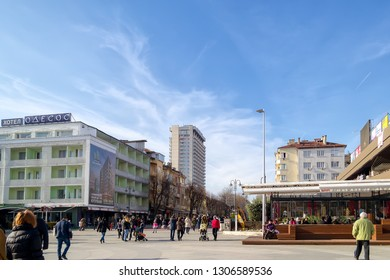 Varna, Bulgaria, February 02 2019. The pedestrian part of the boulevard Slivnitsa on a sunny winter day, the favorite place of citizens and tourists for walkins. The Black Sea Hotel is in a distance.