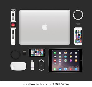 Varna, Bulgaria - February 11, 2015: Top view of Apple products tech mockup that includes retina macbook pro, ipad air 2, smart watch concept, iphone 5s, magic mouse, flash drive, bracelets.