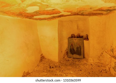 VARNA, BULGARIA - JANUARY 20, 2019: Picturesque cave, skete of the Aladzha rock monastery. The stone of old monastic Christian cell in XIV century church-historical museum of Orthodox Christianity