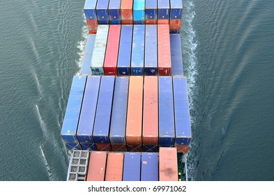 VARNA, BULGARIA - JANUARY 20: Cargo ship DS BLUE OCEAN (Flag: United Kingdom, IMO: 9341976) sails into open sea on January 20, 2011 in Varna, Bulgaria. Containers on board the ship seen from above.