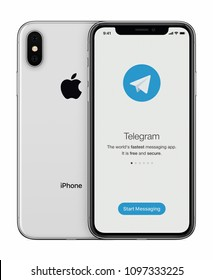 Varna, Bulgaria - January 23, 2018: Telegram messenger launch screen with Telegram logo on Apple iPhone X display isolated on white background.