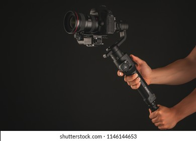 Varna, Bulgaria - July 11 ,2018: DJI Ronin-S is Three-Axis Motorized Gimbal Stabilizer for DSLR or Mirrorless Cameras manufactured by DJI company ,isolated on black.