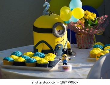 Varna, Bulgaria - July 25, 2020 - Minions Party Cake, kids birthday party ideas, yellow and blue minion, children 2 b-day party concept