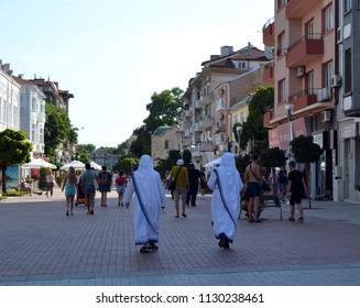 Varna, Bulgaria, june 2018. Two missionaries of charity walk along a pedestrian street in the tourist part of the Varna.