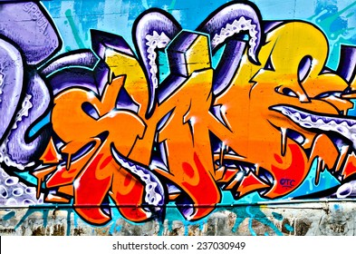 """VARNA, BULGARIA - JUNE 5, 2011: Fraction from the vast Eighty meters long graffiti painted on a concrete wall at Port of Varna as part of the """"Creatures from Black Sea"""" Sprite Graffiti Jam 2011."""