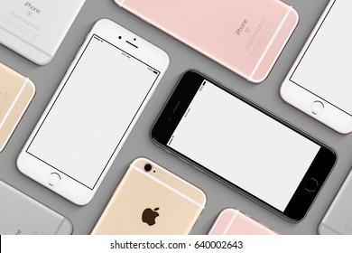 Varna, Bulgaria - March 10, 2016: Set of Apple iPhones 6s mockup top view flat lay with white screen and back side lies on gray surface. High quality studio shot made in Apple style.
