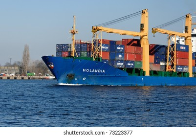 VARNA, BULGARIA - MARCH 14: Cargo ship HOLANDIA (Flag: Antigua Barbuda, Year Built: 2000) sails into Port of Varna-West to be loaded with containers on March 14, 2011 in Varna, Bulgaria.