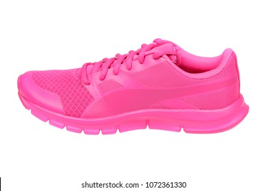 Varna , Bulgaria - MARCH 28, 2018 PUMA FLEXRACER pink sport shoe. Puma is a German company. PUMA is the third largest sportswear manufacturer in the world. Isolated on white. Product shots
