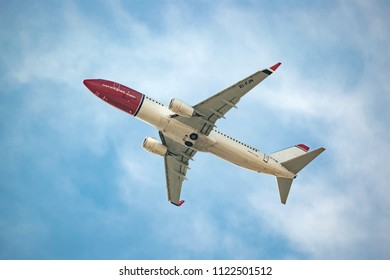 Varna, Bulgaria - March 31, 2018: Commercial passenger jet airliner Boeing  737-800 B738 of Norwegian Air International Airlines in flight after take off from Varna airport. Travel tourism concept.