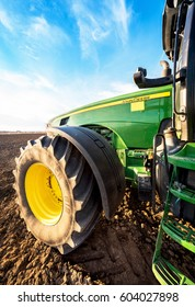Varna, Bulgaria - March 5, 2017 Ploughing a field with John Deere tractor. John Deere was manufactured in 1995-1999 and it has JD 7.6L or 8.1L 6-cyl diesel engine.