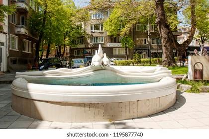 VARNA, BULGARIA - MAY 02, 2017: Fountain with dophins near St. Nicolas church on boulevard knyaz Boris I, Varna, Bulgaria