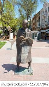 VARNA, BULGARIA - MAY 02, 2017: Monument to man with fish on boulevard knyaz Boris I