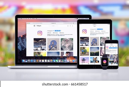 Varna, Bulgaria - May 23, 2017: Instagram on the Apple MacBook Pro, Instagram app on iPad Pro and on iPhone 7, Instagram notification icon on Apple Watch. Office desk responsive concept.