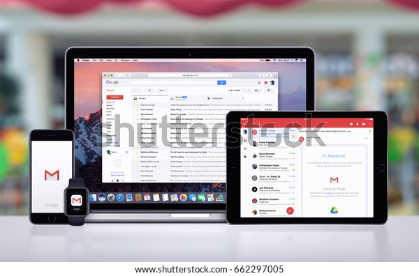 Varna, Bulgaria - May 23, 2017: Google Gmail page on the Apple MacBook, Gmail app on iPad Pro, Gmail splash screen with logo on iPhone 7 and notification icon on Apple Watch. Office desk concept.