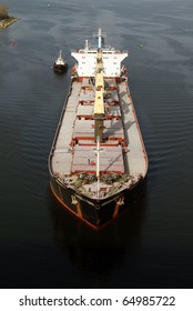 VARNA, BULGARIA - NOVEMBER 11: Cargo ship SERVET-Y (Flag: Turkey) sails  into open sea after being loaded with 30 000 tonnes of triple superphosphate on November 11, 2010 in Varna, Bulgaria.