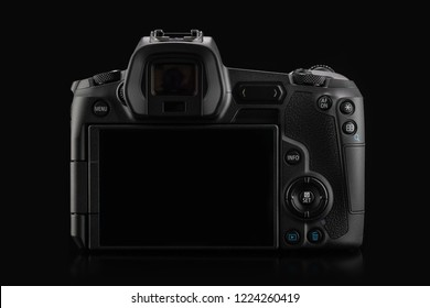 Varna, Bulgaria - October 11,2018: Image of Canon EOS R Mirrorless Digital Camera with Canon EF 24-105mm f4L IS USM lens on a black background. Canon is the world largest SLR camera manufacturer.