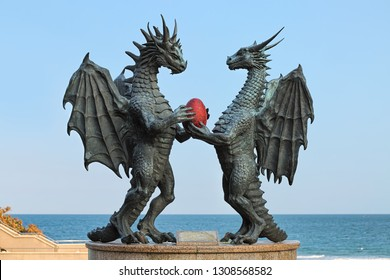 VARNA, BULGARIA - OCTOBER 4, 2017: Dragons in Love sculpture in the city's Sea Garden at the coast of Black Sea. The sculpture by artist Darin Lazarov was erected in October 2010.