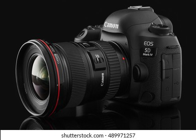 Varna, Bulgaria - September 24, 2016: Canon 5D Mark IV camera with Canon EF 16-35mm f/2.8L II USM lens on a black background. Canon is the world largest SLR camera manufacturer.