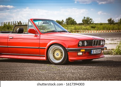 Varna, Bulgaria - September 25, 2018: BMW E30 M3 cabrio on race track ready to drift. LED headlights. Classic retro car. Old school. Wide fenders and BBS forged rims. Beautiful cloudy blue sky
