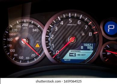 Varna, Bulgaria - September 25, 2018: Nissan GTR R50 2018 close up speedometer scoring high speed. Sporty Car Dashboard Instruments illuminated at night. Rev counter. Modern racecar Vehicle cluster