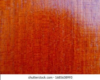 Varnished mahogany wood background close up