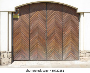 Varnished Ornate carved Garage Door in Jaen, Spain