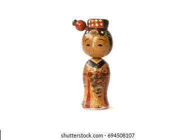 Varnished wood kokeshi doll isolated on white background.