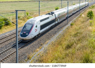Varreddes, France - August 18, 2018: A high speed TGV Duplex train in Carmillon livery from french company SNCF driving on the LGV Est, the East European high speed railway line, in the countryside.