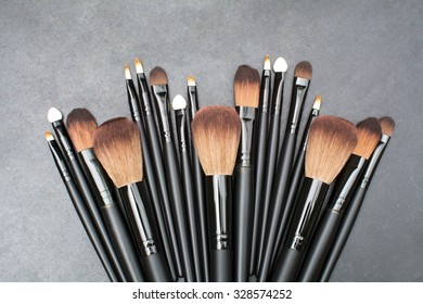varsity size makeup brushes set on blackboard background