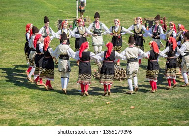 VARVARA, BULGARIA - MARCH 24, 2019: Moment from National Festival Dervish Varvara presents traditions of Bulgarian Kuker Games. Dancers play traditional Bulgarian folklore Horo dance