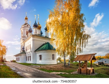 The Varvarinskaya Church in the autumn Plyos and the wooden well in the light of a sunny day