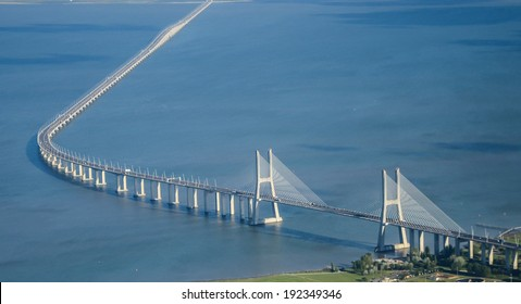 The Vasco da Gama Bridge is a cable-stayed bridge flanked by viaducts and rangeviews that spans the Tagus River in Parque das Nações in Lisbon, the capital of Portugal