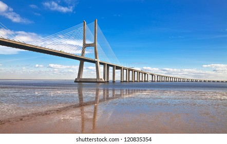 Vasco da Gama bridge in Lisbon, Portugal. On Blue Sky