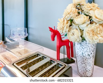 Vase of artificial flower, toaster decoration on self-service table  / food and drink lifestyle concept