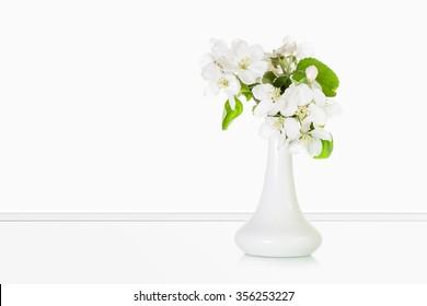 Vase with beautiful flowers, interior decor.