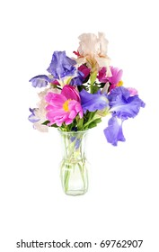 A vase of beautiful spring flowers isolated on a white high key background, vertical with copy space