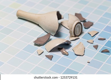 The vase broke on the floor