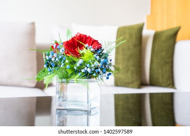 Vase flower on table with pillow on sofa decoration interior of living room