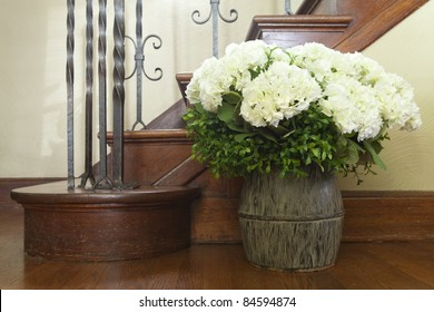 Vase of flowers at the base of stairs