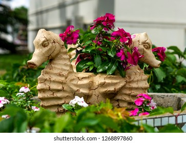 Vase with flowers in the form of seahorse
