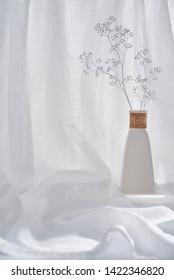 Vase on a white cloth.