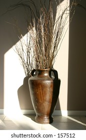 Vase with twigs and branches