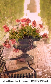 Vase with typical Dutch tulips in vintage style