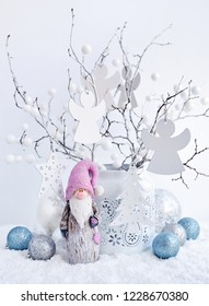 Vase with white branches, gnome and Christmas toys оn the snow. Christmas or New Year greeting card.