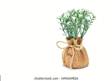 Vases of flowers, Artificial lavender in burlap with isolated on white background. Great to use for decorating weddings or party decoration. Copy space, Selective focus.