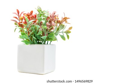 Vases of flowers, Artificial orange and green flower bouquet with white vase for home or party decoration isolated on white background. Copy space, Selective focus.