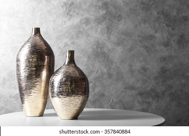 Vases on table in the room