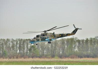 Vasilkov, Ukraine - April 24, 2012: Ukrainian Air Force Mi-24 attack helicopter is landing on the runway of the airfield