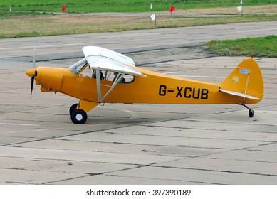 Vasilkov, Ukraine - July 03, 2013. Light aircraft Piper PA-18-150 Super Cub taxing.